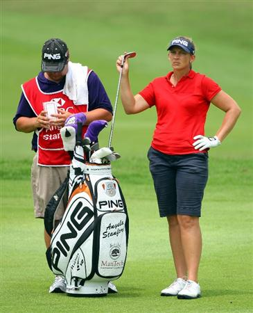 SINGAPORE - MARCH 07:  Angela Stanford of the USA waits with her caddie on the 16th hole during the third round of the HSBC Women's Champions at Tanah Merah Country Club on March 7, 2009 in Singapore.  (Photo by Andrew Redington/Getty Images)