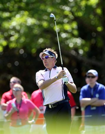 ORLANDO, FL - MARCH 14:  Ian Poulter of England plays a shot on the 5th hole during the first day of the Tavistock Cup at Isleworth Golf and Country Club on March 14, 2011 in Orlando, Florida.  (Photo by Sam Greenwood/Getty Images)