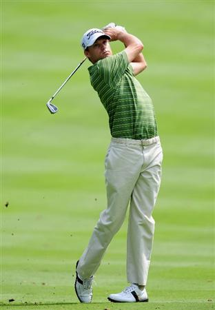 AKRON, OH - AUGUST 05:  Nick Watney of USA plays his approach shot during a practice round of the World Golf Championship Bridgestone Invitational on August 5, 2009 at Firestone Country Club in Akron, Ohio.  (Photo by Stuart Franklin/Getty Images)