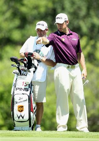 SUN CITY, SOUTH AFRICA - DECEMBER 04:  Lee Westwood of England points out the line of a putt on the seventh green to his caddie Billy Foster during the third round of the 2010 Nedbank Golf Challenge at the Gary Player Country Club Course  on December 4, 2010 in Sun City, South Africa.  (Photo by Warren Little/Getty Images)