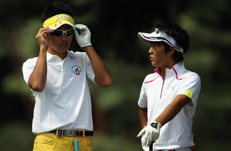 KAWAGOE CITY, JAPAN - OCTOBER 10:  Hideki Matsuyama of Japan tries on the sunglasses of Yosuke Asaji of Japan as they wait to hit during the final round of the 2010 Asian Amateur Championship at Kasumigaseki Country Club on October 10, 2010 in Kawagoe City, Japan.  (Photo by Streeter Lecka/Getty Images)