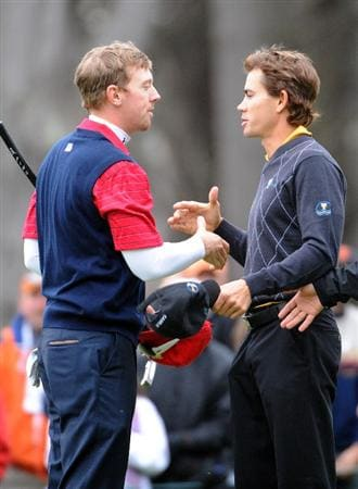 SAN FRANCISCO - OCTOBER 11:  Hunter Mahan of the USA Team shakes hands with Camilo Villegas of the International Team after his 2 and 1 win on the 17th green during the Day Four Singles Matches of The Presidents Cup at Harding Park Golf Course on October 11, 2009 in San Francisco, California.  (Photo by Harry How/Getty Images)