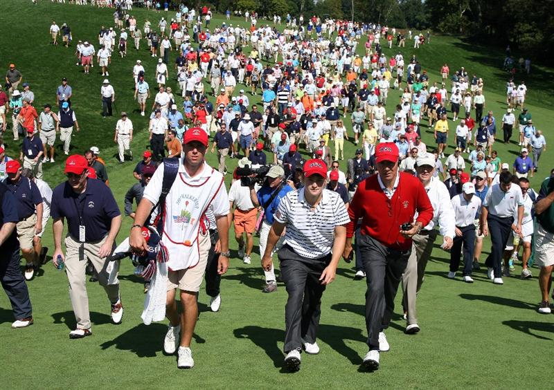 ARDMORE, PA - SEPTEMBER 13:  Bud Cauley of the USA and his team captain Buddy Marucci walk ahead of the huge gallery at the 18th hole in his match against Stiggy Hodgson of England and Niall Kearney of Ireland and the Great Britain and Ireland Team during the morning foursome matches on the East Course at Merion Golf Club on September 13, 2009 in Ardmore, Pennsylvania.  (Photo by David Cannon/Getty Images)