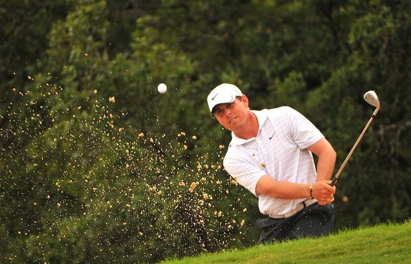 SAN ANTONIO TX - MAY 16: Justin Leonard blasts out of the greenside bunker on the 3rd hole during the third round of  the Valero Texas Open held at La Cantera Golf Club on May 16, 2009 in San Antonio, Texas.  (Photo by Marc Feldman/Getty Images)