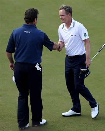 VIRGINIA WATER, ENGLAND - MAY 29:  Lee Westwood (L) of England congratulates Luke Donald of England on his victory in a playoff during the final round of the BMW PGA Championship  at the Wentworth Club on May 29, 2011 in Virginia Water, England.  (Photo by Andrew Redington/Getty Images)