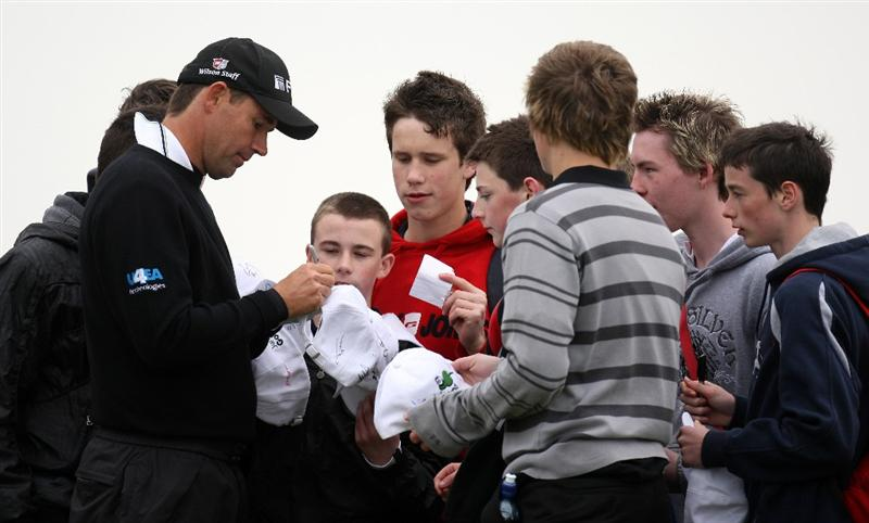 BALTRAY, IRELAND - MAY 13:  Padraig Harrington of Ireland signs autographs during the Pro-Am prior to the start of The 3 Irish Open at County Louth Golf Club on May 13, 2009 in Baltray, Ireland.  (Photo by Ross Kinnaird/Getty Images)