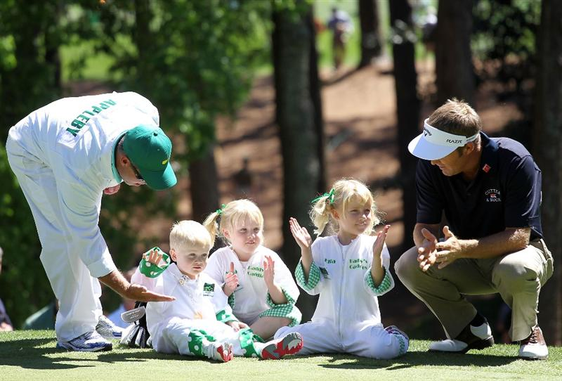 AUGUSTA, GA - APRIL 06:  Stuart Appleby talks with his children (L-R) Max, Mia, and Ella watch the action during the Par 3 Contest prior to the 2011 Masters Tournament at Augusta National Golf Club on April 6, 2011 in Augusta, Georgia.  (Photo by Jamie Squire/Getty Images)