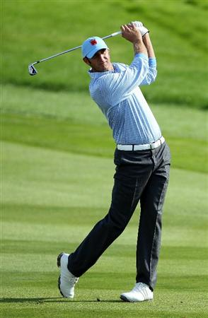 NEWPORT, WALES - SEPTEMBER 28:  Dustin Johnson of the USA hits an approach shot during a practice round prior to the 2010 Ryder Cup at the Celtic Manor Resort on September 28, 2010 in Newport, Wales. (Photo by Andy Lyons/Getty Images)