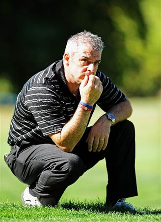 PARIS - SEPTEMBER 25:  Paul McGinley, Captain of THe Great Britian and Northern Ireland team ponders during the second day fourball at The Vivendi Trophy with Severiano Ballesteros at Saint - Nom - La Breteche golf course on September 25, 2009 in Paris, France.  (Photo by Stuart Franklin/Getty Images)