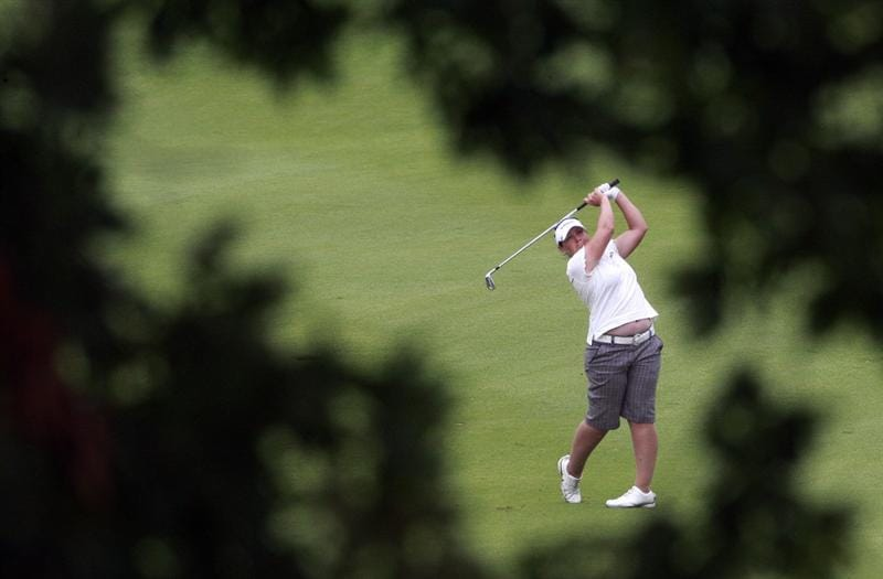ROGERS, AR - SEPTEMBER 13:  Karen Stupples of England hits her approach shot to the ninth green during final round play in the P&G Beauty NW Arkansas Championship at the Pinnacle Country Club on September 13, 2009 in Rogers, Arkansas.  (Photo by Dave Martin/Getty Images)