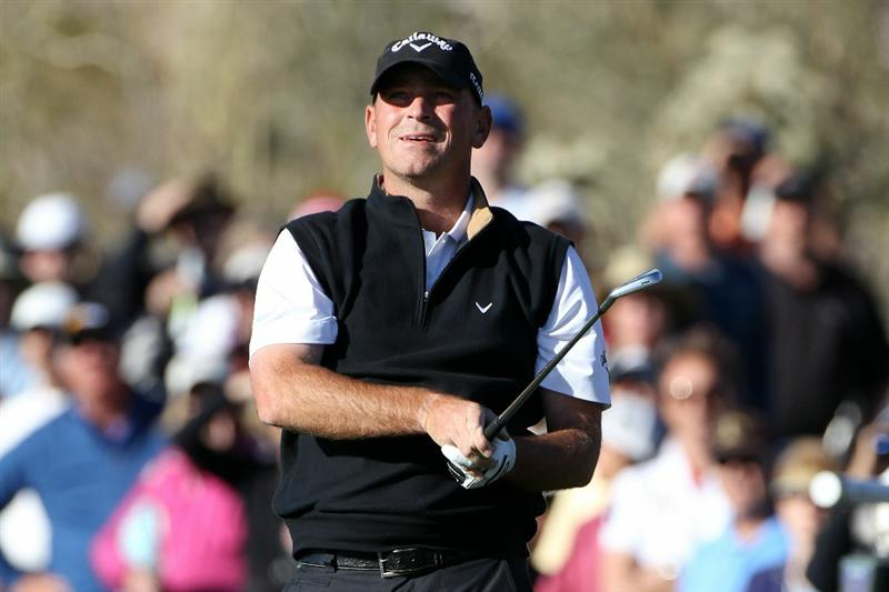 MARANA, AZ - FEBRUARY 23:  Thomas Bjorn of Denmark watches his shot from the fairway on the 17th hole during the first round of the Accenture Match Play Championship at the Ritz-Carlton Golf Club on February 23, 2011 in Marana, Arizona.  (Photo by Sam Greenwood/Getty Images)