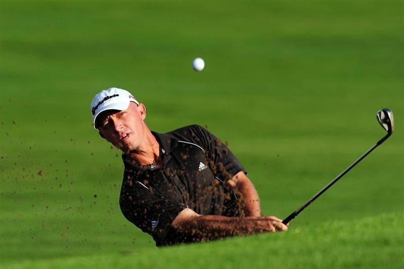 CHASKA, MN - AUGUST 13:  Nathan Green of Australia plays a bunker shot on the first hole during the first round of the 91st PGA Championship at Hazeltine National Golf Club on August 13, 2009 in Chaska, Minnesota.  (Photo by Stuart Franklin/Getty Images)
