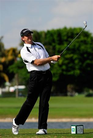 DORAL, FL - MARCH 12:  Retief Goosen of South Africa plays a shot on the 9th hole during the first round of the World Golf Championships-CA Championship at the Doral Golf Resort & Spa on March 12, 2009 in Miami, Florida.  (Photo by Sam Greenwood/Getty Images)