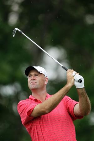 CHASKA, MN - AUGUST 13:  Stewart Cink watches his tee shot on the eighth hole during the first round of the 91st PGA Championship at Hazeltine National Golf Club on August 13, 2009 in Chaska, Minnesota.  (Photo by Jamie Squire/Getty Images)