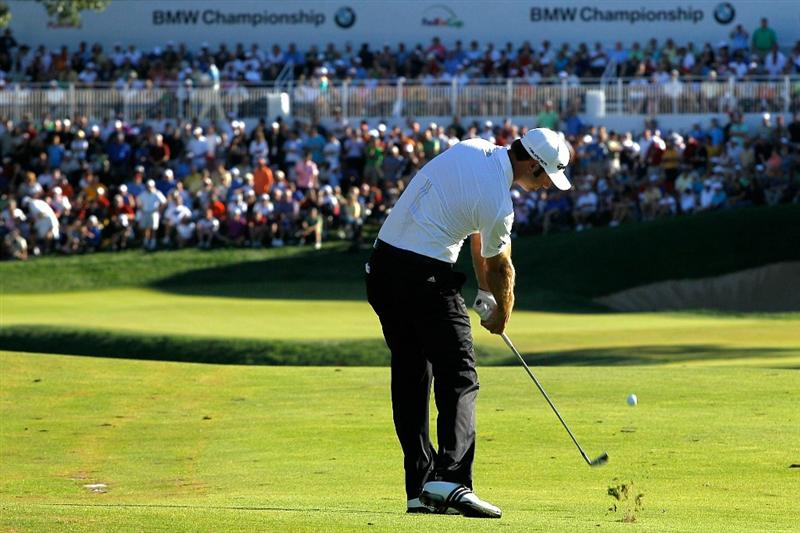 LEMONT, IL - SEPTEMBER 12:  Dustin Johnson plays a shot to the 18th green during the final round of the BMW Championship at Cog Hill Golf & Country Club on September 12, 2010 in Lemont, Illinois.  (Photo by Scott Halleran/Getty Images)