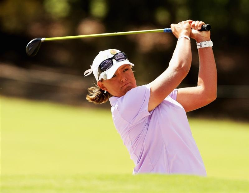 MELBOURNE, AUSTRALIA - FEBRUARY 12:  Katherine Hull of Australia plays an approach shot on the 12th hole during day one of the 2009 Women's Australian Open held at the Metropolitan Golf Club February 12, 2009 in Melbourne, Australia.  (Photo by Mark Dadswell/Getty Images)