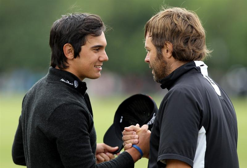 VIRGINIA WATER, ENGLAND - MAY 28:  Matteo Manassero of Italy shakes hands with Jose Manuel Lara (R) of Spain on the 18th green during the third round of the BMW PGA Championship at the Wentworth Club on May 28, 2011 in Virginia Water, England.  (Photo by Ian Walton/Getty Images)