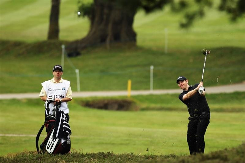 VIRGINIA WATER, ENGLAND - MAY 20:  Stephen Gallacher plays a shot on the 11th during the first round of the BMW PGA Championship on the West Course at Wentworth on May 20, 2010 in Virginia Water, England.  (Photo by Ross Kinnaird/Getty Images)