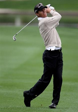 LA QUINTA, CA - JANUARY 20:  John Senden of Australia hits his second shot from the eighth fairway during the first round of the Bob Hope Classic at the La Quinta Country Club on January 20, 2010 in La Quinta, California.  (Photo by Jeff Gross/Getty Images)
