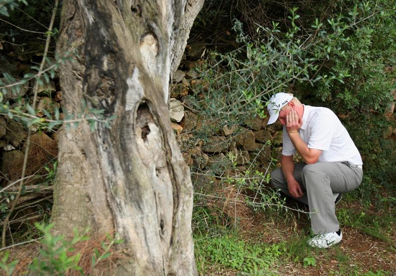 CASTELLO, SPAIN - OCTOBER 25:  Richard Finch of England ponders his approach shot on the 14th hole during the third round of the Castello Masters Costa Azahar at the Club de Campo del Mediterraneo on October 25, 2008 in Castello, Spain.  (Photo by Stuart Franklin/Getty Images)