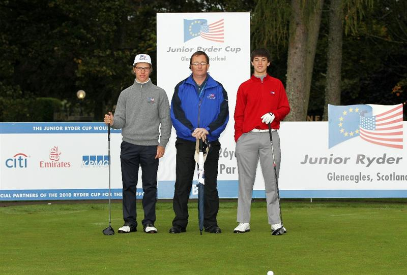 GLENEAGLES, SCOTLAND - SEPTEMBER 28:  (L-R) Juhana Kukkonen, referee Charles Dernie and Oliver Schniederjans pose for a photograph at the start of the second day of play at the Junior Ryder Cup at Gleneagles on September 28 2010 near Muirton, Scotland. (Photo by Ian MacNicol/Getty Images)