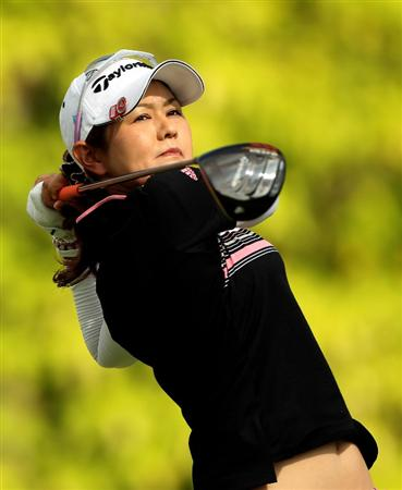 SINGAPORE - FEBRUARY 27:  Shinobu Moromizato of Japan hits her tee-shot on the sixth hole during the third round of the HSBC Women's Champions at the Tanah Merah Country Club on February 27, 2010 in Singapore.  (Photo by Andrew Redington/Getty Images)