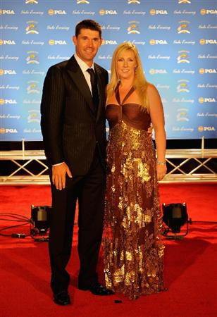LOUISVILLE, KY - SEPTEMBER 17:  Padraig Harrington of Ireland and the European Ryder Cup team poses with his wife Caroline on the red carpet before the Ryder Cup Gala dinner prior to the start of the 2008 Ryder Cup September 17, 2008 in Louisville, Kentucky. (Photo by Sam Greenwood/Getty Images)