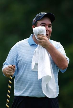 GREENSBORO, NC - AUGUST 21:  Kevin Stadler wipes his face on the 17th hole during the second round of the Wyndham Championship at Sedgefield Country Club on August 21, 2009 in Greensboro, North Carolina  (Photo by Streeter Lecka/Getty Images)