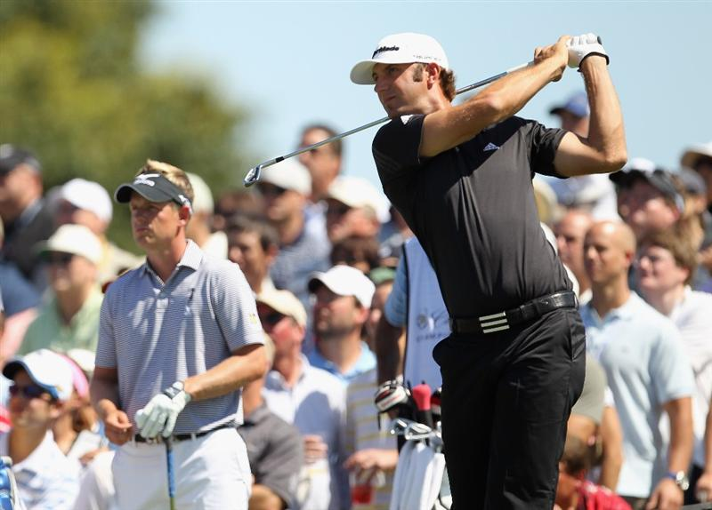 DORAL, FL - MARCH 13:  Dustin Johnson watches his tee shot on the second hole as Luke Donald of England looks onduring the final round of the 2011 WGC- Cadillac Championship at the TPC Blue Monster at the Doral Golf Resort and Spa on March 13, 2011 in Doral, Florida.  (Photo by Mike Ehrmann/Getty Images)