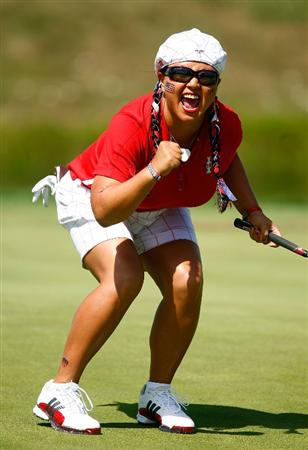SUGAR GROVE, IL - AUGUST 23:  Christina Kim of the U.S. Team celebrates a birdie putt on the second hole during the Sunday singles matches at the 2009 Solheim Cup at Rich Harvest Farms on August 23, 2009 in Sugar Grove, Illinois.  (Photo by Scott Halleran/Getty Images)