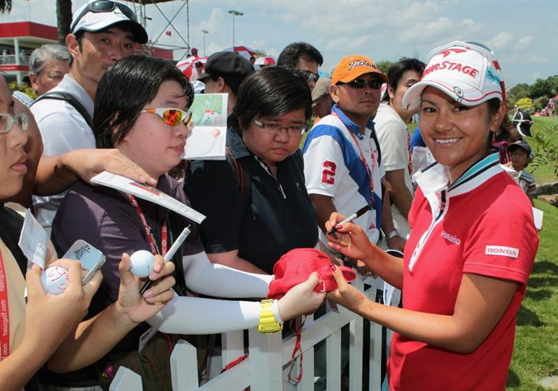 SINGAPORE - FEBRUARY 26:  Ai Miyazato of Japan signs autographs for fans after the third round of the HSBC Women's Champions 2011 at the Tanah Merah Country Club on February 26, 2011 in Singapore, Singapore.  (Photo by Scott Halleran/Getty Images)