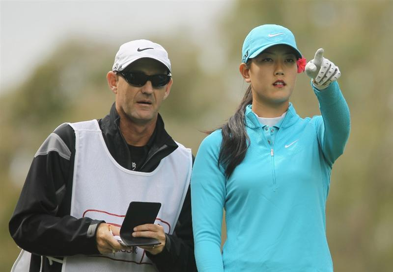 CITY OF INDUSTRY, CA - MARCH 26:  Michelle Wie points to the eighth green as her caddie Brendan Woolley looks on during the third round of the Kia Classic on March 26, 2011 at the Industry Hills Golf Club in the City of Industry, California.  (Photo by Scott Halleran/Getty Images)
