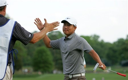 CHARLOTTE, NC - MAY 04: Anthony Kim celebrates with his caddie after winning the Wachovia Championship at Quail Hollow Country Club on May 4, 2008 in Charlotte, North Carolina. (Photo by Streeter Lecka/Getty Images)