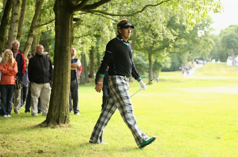 VIRGINIA WATER, ENGLAND - MAY 26:  Ian Poulter of England walks out of the woods after taking his second shot on the 17th hole during the first round of the BMW PGA Championship at Wentworth Club on May 26, 2011 in Virginia Water, England.  (Photo by Ian Walton/Getty Images)