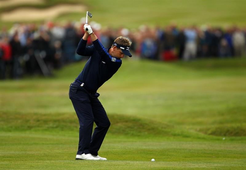 VIRGINIA WATER, ENGLAND - MAY 27:  Luke Donald of England hits his 2nd shot on the 15th hole during the second round of the BMW PGA Championship at the Wentworth Club on May 27, 2011 in Virginia Water, England.  (Photo by Richard Heathcote/Getty Images)