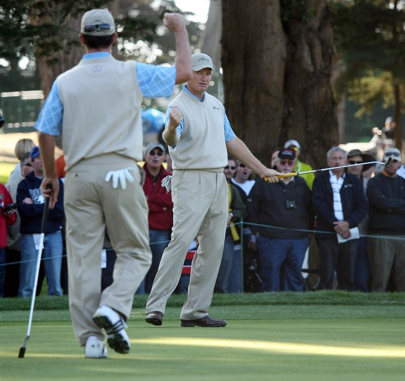 SAN FRANCISCO - OCTOBER 09:  Ernie Els of the International Team celebrates with team mate Mike Weir on the 17th green during the Day Two Fourball Matches of The Presidents Cup at Harding Park Golf Course on October 9, 2009 in San Francisco, California.  (Photo by Warren Little/Getty Images)