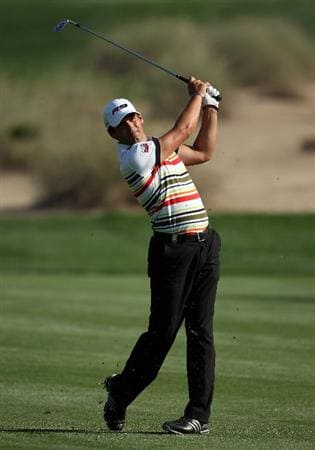 DUBAI, UNITED ARAB EMIRATES - JANUARY 30:  Lee Slattery of England hits his second shot on the 14th hole during the second round of the Dubai Desert Classic on the Majilis course at Emirates Golf Club on January 30, 2009 in Dubai, United Arab Emirates.  (Photo by Andrew Redington/Getty Images)