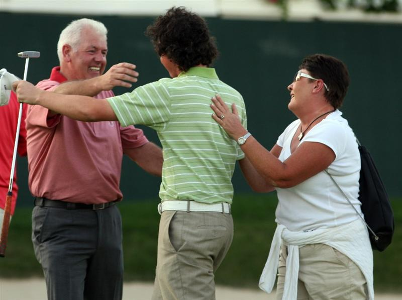 DUBAI, UNITED ARAB EMIRATES - FEBRUARY 01:  Rory McIlroy of Northern Ireland celebrates with his parents after winning the Dubai Desert Classic. The final round of the Dubai Desert Classic played on the Majlis Course on February 1, 2009 in Dubai,United Arab Emirates.  (Photo by Ross Kinnaird/Getty Images)