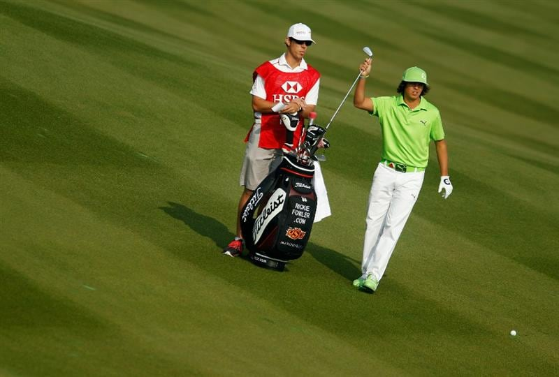SHANGHAI, CHINA - NOVEMBER 05:  Rickie Fowler of the USA pulls a club on the second hole during the second round of the HSBC Champions at the Sheshan Golf Club on November 5, 2010 in Shanghai, China.  (Photo by Scott Halleran/Getty Images)
