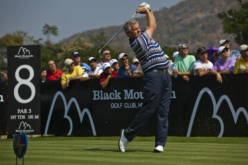 HUA HIN, THAILAND - JANUARY 08: Colin Montgomerie of Scotland tees off on the 8th hole during day one of The Royal Trophy tournament at Black Mountain Golf Club on January 8, 2011 in Hua Hin, Thailand.  (Photo by Athit Perawongmetha/Getty Images)