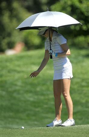 RANCHO MIRAGE, CA - APRIL 01:  Sandra Gal of Germany checks her lie on the 11th fairway as she holds an umbrella in the heat during the second round of the Kraft Nabisco Championship at Mission Hills Country Club on April 1, 2011 in Rancho Mirage, California.  (Photo by Stephen Dunn/Getty Images)