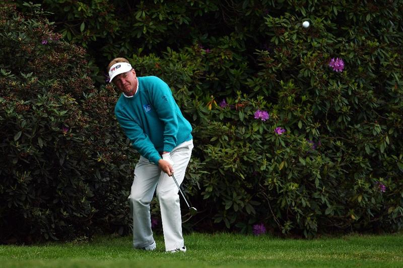 WENTWORTH, ENGLAND - MAY 21:  Paul Broadhurst of England plays from under a tree on the 18th hole during the First Round of the BMW PGA Championship at Wentworth on May 21, 2009 in Virginia Water, England.  (Photo by Richard Heathcote/Getty Images)
