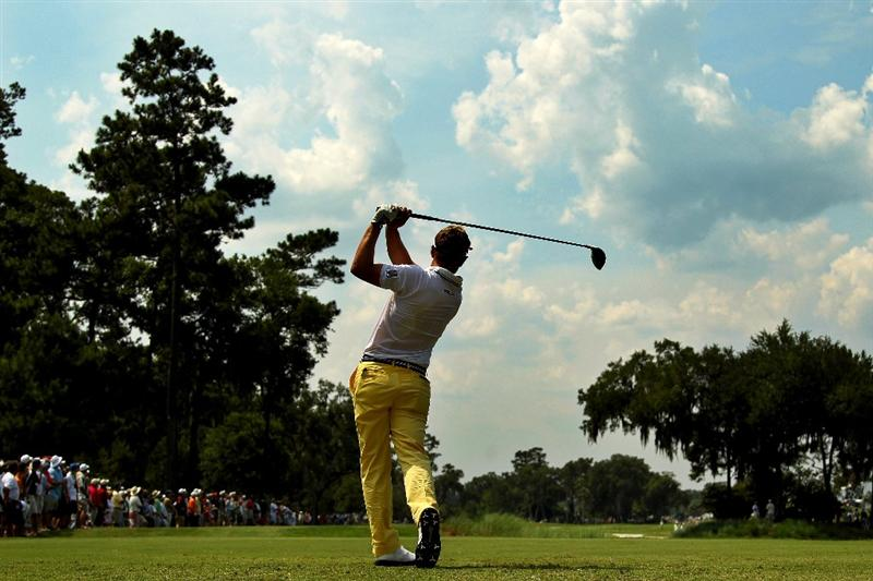 PONTE VEDRA BEACH, FL - MAY 13:  Luke Donald of England hits his tee shot on the ninth hole during the second round of THE PLAYERS Championship held at THE PLAYERS Stadium course at TPC Sawgrass on May 13, 2011 in Ponte Vedra Beach, Florida.  (Photo by Mike Ehrmann/Getty Images)
