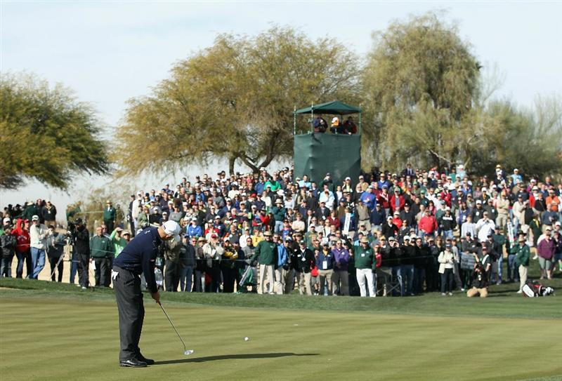 SCOTTSDALE, AZ - FEBRUARY 05:  Bill Haas putts for birdie on the second hole green during the second round of the Waste Management Phoenix Open at TPC Scottsdale on February 5, 2011 in Scottsdale, Arizona.  (Photo by Christian Petersen/Getty Images)