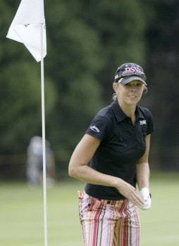 Jill McGill smiles after sinking her approach shot for an eagle on the fifth hole during the final round of the 2005 Safeway Classic at Columbia Edgewater Country Club in Portland, Oregon on Sunday,  August 21, 2005.Photo by Allan Campbell/WireImage.com