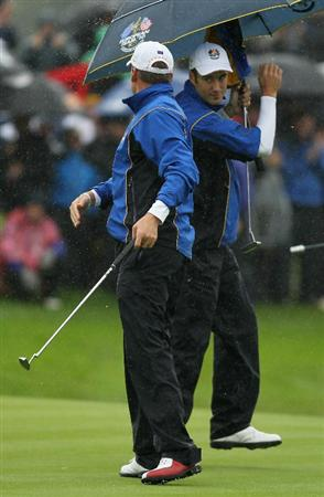 NEWPORT, WALES - OCTOBER 01:  Ian Poulter and Ross Fisher of Europe celebrate a birdie putt on the third green during the Morning Fourball Matches during the 2010 Ryder Cup at the Celtic Manor Resort on October 1, 2010 in Newport, Wales.  (Photo by Andy Lyons/Getty Images)