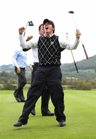 NEWPORT, WALES - OCTOBER 03:  Rory McIlroy (R) of Europe celebrates holing a putt with team mate Graeme McDowell to wiin their match on the 17th green during the  Fourball & Foursome Matches during the 2010 Ryder Cup at the Celtic Manor Resort on October 3, 2010 in Newport, Wales.  (Photo by Jamie Squire/Getty Images)