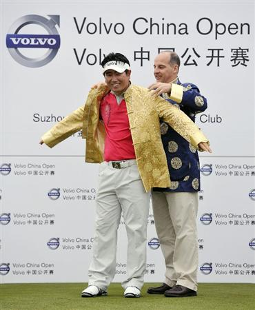 SUZHOU, CHINA - APRIL 18:  Y.E. Yang (L)  of Korea receives a Chinese gold jacket from Dr. Alexander Klose, President of Volvo Cars China, after winning the Volvo China Open on April 18, 2010 in Suzhou, China.  (Photo by Victor Fraile/Getty Images)