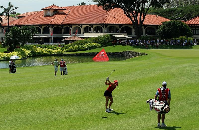 SINGAPORE - MARCH 06:  Natalie Gulbis of the USA hits her approach shot on the ninth hole during the second round of the HSBC Women's Champions at the Tanah Merah Country Club on March 6, 2009 in Singapore  (Photo by Scott Halleran/Getty Images)