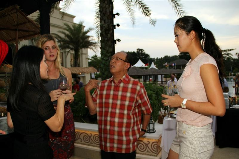 KUALA LUMPUR, MALAYSIA - OCTOBER 20: Michelle Wie (R) of the United States and Sime Darby Chairman Musa Hitam (2R) talks with guests during the Sime Darby LPGA Welcome Party on October 20, 2010 at the KLGCC Golf Course in Kuala Lumpur, Malaysia.  (Photo by Stanley Chou/Getty Images)
